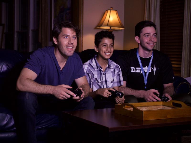 Jimmy Naples (right), one of the directors of Kent State University Independent Films' fifth feature length film, Fly By Night, sits down with our actors Matthew Divis (left) and Kerolos Beshay (middle) to show them how to get into the mindset of a gamer..